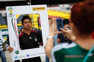 A man has his picture taken during an event to exchange stickers for the official 2014 FIFA World Cup sticker album at the Azteca Stadium in Mexico. Italian publishing company Panini has issued a sticker album for every World Cup since the 1970 tournament in Mexico.