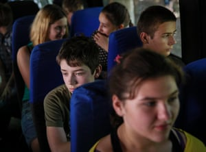 Children sit in a bus as they flee from fighting in Slavyansk, Ukraine as the country's new president Petro Poroshenko said his country would never give up Crimea and would not compromise on its path towards closer ties with Europe.