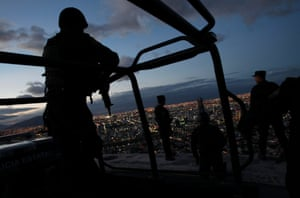 Members of the Fuerza Civil police keep watch at the Independencia neighbourhood in Monterrey, Mexico. Members of the Fuerza Civil, a tactical team of the police unit trained by the army, patrol the area to curb down gang violence and drug trafficking.