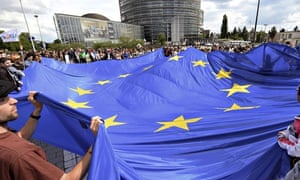 People hold a giant European Union flag in France