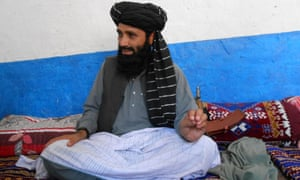 Azam Tariq, a leader of Tehreek-e-Taliban Pakistan, talks with media in North Waziristan on May 27. A major faction of the Pakistani Taliban announced on May 28 it was splitting from the militant outfit following bloody clashes with a rival group since March.