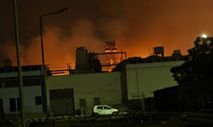 Fire illuminate the sky above Jinnah International Airport in Karachi