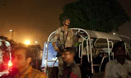 Pakistani security troops rush to Jinnah International Airport in Karachi