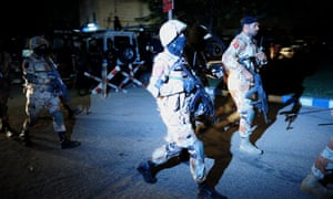 Pakistani security personnel arrive at Jinnah International Airport in Karachi earlier in the evening.