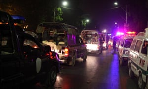 Pakistani security officials and ambulances arrive at at the Jinnah International Airport earlier this evening.