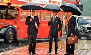 Have we lost our way since the 1960s? A trio of bowler hatted gentlemen shelter from the rain.