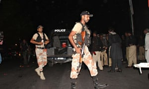 Pakistani rangers patrol outside Karachi airport following an attack by gunmen.