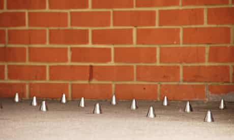 A set of inch-high studs in a doorway of an apartment block in London