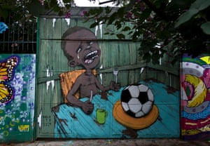 Graffiti painted by Brazilian street artist Paulo Ito of depicting a starving child with nothing to eat but a football.