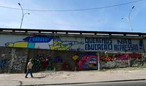Graffiti depicting the 2014 World Cup mascot Fuleco the Armadillo pointing a rifle at a message that reads 'We Want Education' and 'Not Repression'.