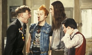 Rik Mayall (left) as Rick in The Young Ones with Adrian Edmondson, Nigel Planer and Christopher Rya