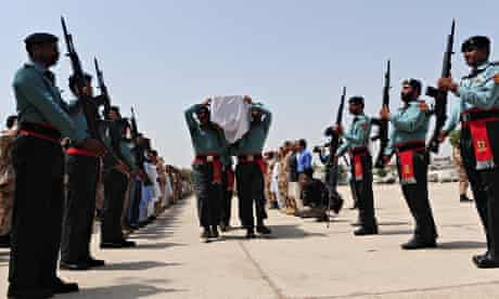 Pakistani army rangers carry the coffin of a comrade killed during the attack on Karachi airport