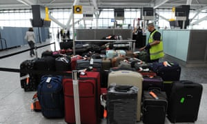 Luggage piles up at Heathrow Airport Terminal Five after the baggage system breaks down.