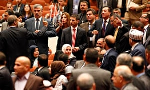 Iraqi politicians gesture at each other after an argument broke out at their parliamentary session