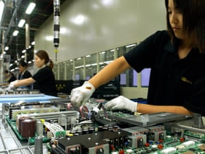 Employees of Samsung Electronics set up large LCD TV on a production line at Samsung Electronics factory in Suwon, south Korea. An audit of Chinese suppliers found multiple infringements of working practices.