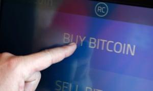 A user buying bitcoin on a Californian bitcoin ATM
