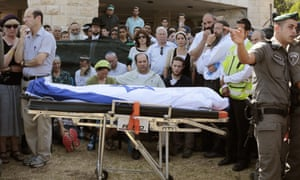 The parents and other family members of Naftali Frenkel, one of the three Israeli teens found dead, attend his funeral service in Nof Ayalon, on 1 July 2014.