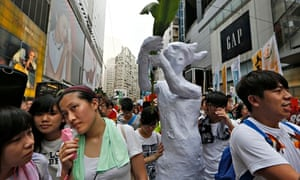 Protesters march for greater democracy from China during an annual protest in Hong Kong, 1 July 2014