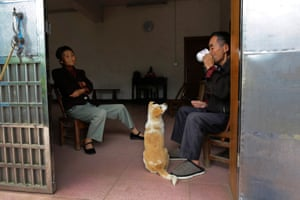 Xiong Demin, 71, who suffers from lung cancer, has breakfast with his 65-year-old wife Wen Jin'e, who suffers from cervical cancer, at Heshan village, in Shimen county, central China's Hunan Province, June 3, 2014.