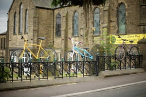 Stones Methodist Church decorates it's fence with cycles on the route of two in Sowerby Bridge.