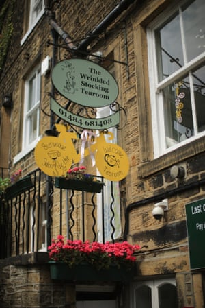 A yellow bicycle hangs from the Wrinkled Stocking Tearoom in Holmfirth