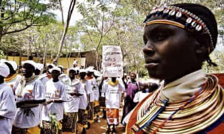 Demonstrators against female genital mutilation march through the village of Marich Pass in Kenya