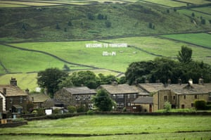 A giant 'Welcome to Yorkshire' sign adorns the dales near Haworth