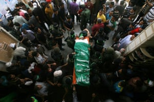 The funeral ceremony is held for Palestinian Mohammed Obeid,who died in an Israeli airstrike in the Gaza Strip on June 30, 2014.