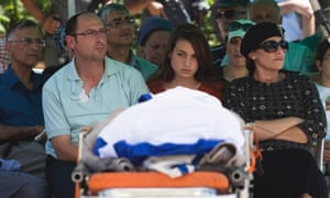 Bat-Galim (front R), Ofir (front L) and Shirel (front C) Shaer, parents and sister of Gilad Shaar, 16, one of three Israeli teens who were abducted and killed in the occupied West Bank.
