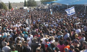 Tens of thousands Israelis attend the joint funeral of Gilad Shaer, 16, Naftali Frenkel, 16, and Eyal Ifrach, 19, in the central Israeli town of Modiin on July 1, 2014.