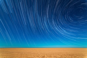 Astronomy Photographer of the Year 2014: Star Trails on the Beach by Sebastián Guillermaz (Argentina)