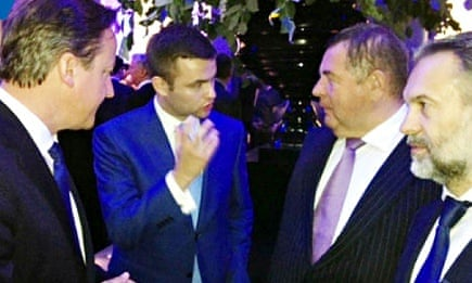 David Cameron speaking at the party to Vasily Shestakov (second right) and Russian billionaire Andrei Kliamko (right), translated by lobbyist Alex Nekrassov (centre).