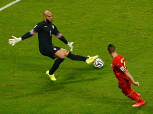 Tim Howard, who's putting in a sterling performance, sticks out his leg to deny Kevin Mirallas