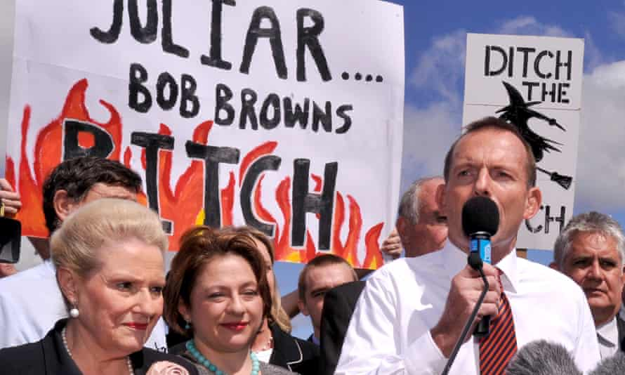 Tony Abbott, flanked by Bronwyn Bishop and Sophie Mirabella, speaks at an anti-carbon tax rally in Canberra in March 2011