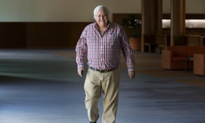 Clive Palmer on his way to the press conference to announce PUP would not support carbon tax repeal for the moment.