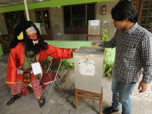 YOGYAKARTA, INDONESIA - JULY 09: A man casts his vote at a polling station with theme of Javanese puppet on July 9, 2014 in Yogyakarta, Indonesia.  Indonesia held its presidential elections on Wednesday, July 9, 2014.  PHOTOGRAPH BY Xinhua /Landov / Barcroft Media  UK Office, London. T +44 845 370 2233 W www.barcroftmedia.com  USA Office, New York City. T +1 212 796 2458 W www.barcroftusa.com  Indian Office, Delhi. T +91 11 4053 2429 W www.barcroftindia.com ballot election elections indonesia indonesian voting president presidential elections voting