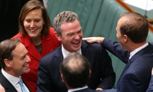BEFORE: Smiles and back slaps for the Government as the carbon tax repeal bills pass in the House of Representatives on June 26.