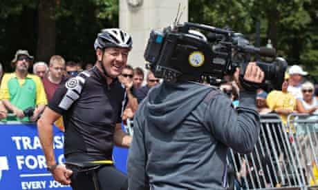Chris Boardman talks to a TV crew during the 3rd stage of Tour de France, July 2014