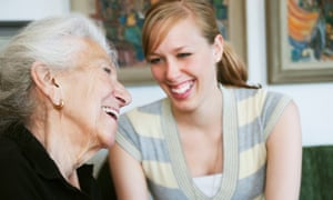 A home carer and older person laughing