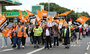 Public sector workers and members of the GMB union make their way through Brighton, as they take par