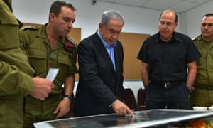 Israeli Prime Minister Benjamin Netanyahu and Israeli Defence Minister Moshe Ya'alon (2-R) during their visit to the Southern Command on Wednesday.