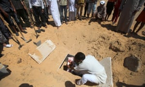 Palestinian mourners bury the body of five-year-old boy Abdallah Abu Ghazal during a funeral ceremony in the northern Gaza town of Beit Lahiya after he was killed in an Israeli air strike.