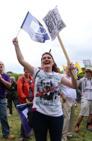 Public sector workers and members of the NUT union make their way through Brighton.