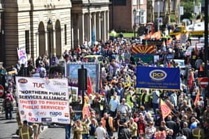Public sector workers march through Newcastle city centre as they take part in the one-day walkout as part of bitter disputes over pay, pensions, jobs and spending cuts.
