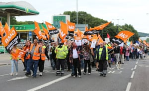 Public sector workers and members of the GMB union make their way through Brighton, as they take part in the one-day walkout as part of bitter disputes over pay, pensions, jobs and spending cuts. PRESS ASSOCIATION Photo. Picture date: Thursday July 10, 2014. Schools across England and Wales were facing closures and disruption today as teachers joined other public sector workers for a national strike. In total, more than a million people were taking part in the one-day walkout. The action has been hailed as the biggest strike over pay to hit the Government since it came to power in 2010.