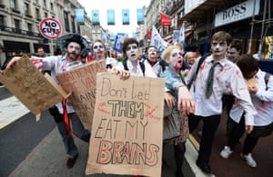 Public sector workers dressed as zombies march through central London during a demonstration against austerity cuts in London, Britain, 10 July 2014. According to media reports, thousands of workers participated in the strike.