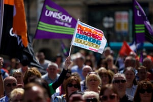TUC members at a strike rally outside St George's Hall in Liverpool, as one million public sector workers are expected to walk out in protest at public sector pay, pensions and working conditions.
