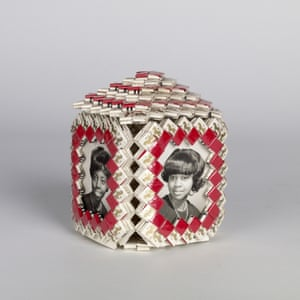 Handmade curio box inset with portraits of an African-American family, silver prints, woven cigarette wrappers, 1970s, American.