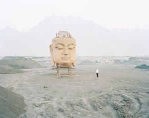 Kechun Zhang, Buddha in Coal Yard, Ningxia Province, 2011.