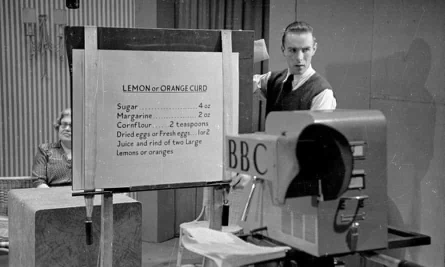 17th April 1948:  A BBC studio team member holds up a recipe board for 'orange or lemon curd' to the camera.